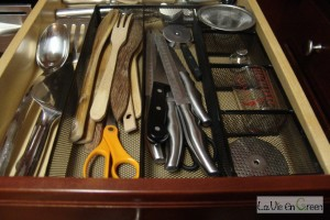 stainless steel and wooden utensils and cutlery