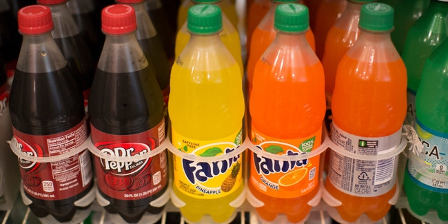 Judge blocks New York City's Bloomberg's big sugary soda drink size limit