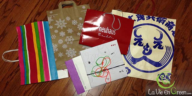 Reusing retailers' pretty Christmas & holiday season's gift bags for sustainable ecofriendly green gift wrapping